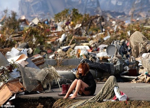 Girl_devastated_after_the_tsunami_that_hit_Japan_in_2011.jpg